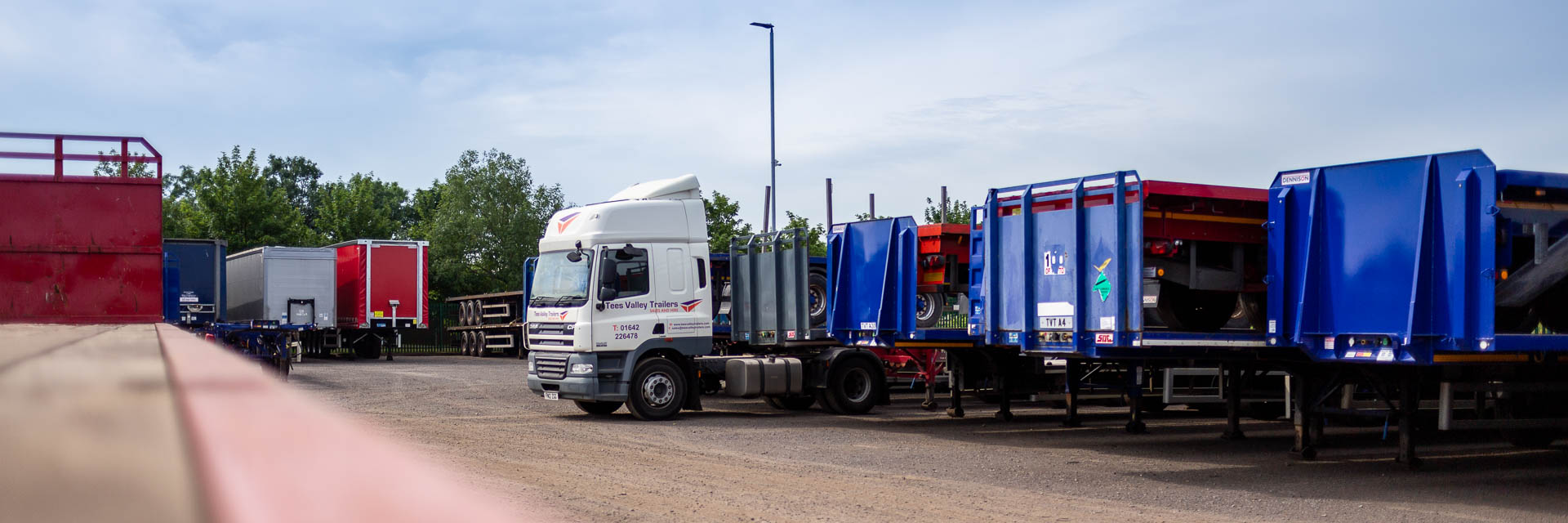 Photo of various types of fully serviced commercial trailers for sale by Tees Valley Trailers. Skeletal, Curtain Sider and Flat trailers are all shown.